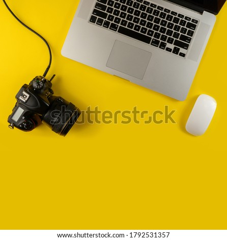 Photographer's equipment.Flat lay composition with photographer's equipment and laptop on yellow background.Photographer's workplace on a yellow background.Copy space