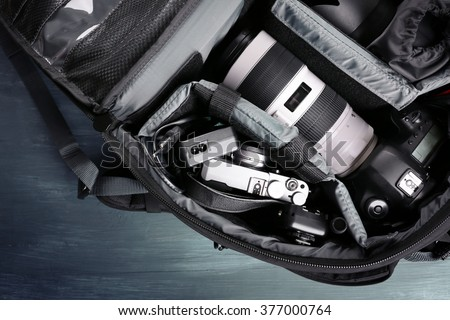 Photographer's equipment on a dark blue background #377000764