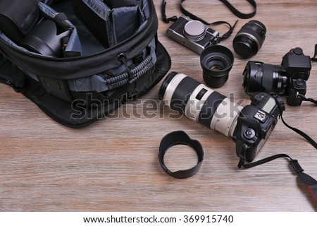 Photographer's equipment on the floor in a room #369915740