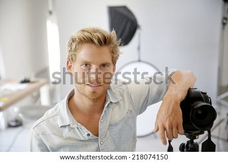 Photographer standing in photo studio