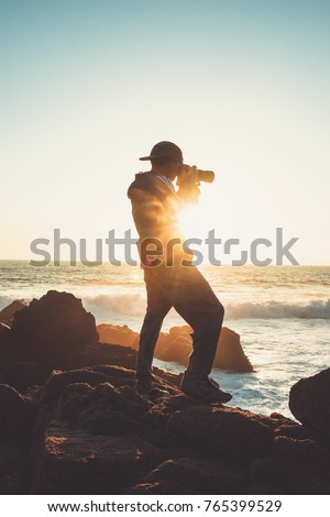 Photographer standing on the cliff