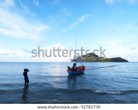 Photographer take a photo of fishing boat at sea in Thailand