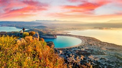 Photographer take a picture of spring view of the Voidokilia beach from Navarino Castle. Great sunrise on the Ionian Sea, Pylos town location, Greece, Europe. Beauty of nature concept background.
