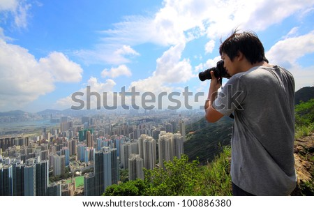 photographer take photo of city