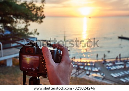 Photographer takes photos of a beautiful sunset