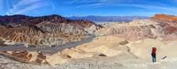 Photographer takes picture of the  Zabriskie point panorama   in Death Valley, California, USA