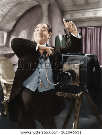 Photographer taking a picture - stock photo
