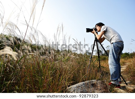 photographer taking photo in wild