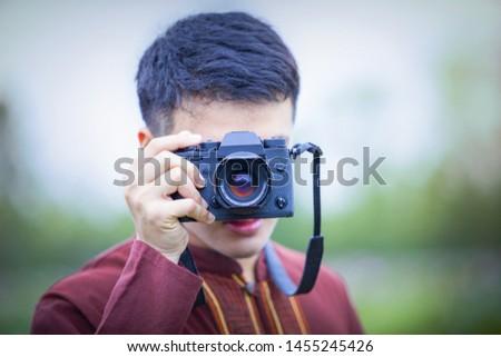 Photographer taking photo of blooming lotus in the lotus pond.Photographer taking photo of blooming lotus at park.