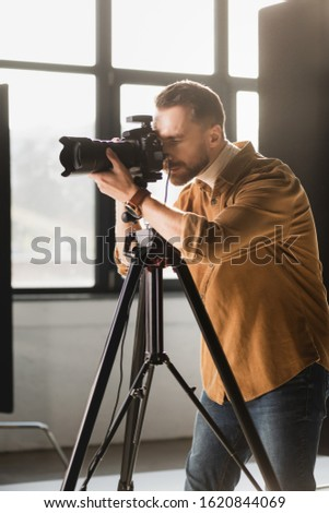 photographer taking photo with digital camera on backstage