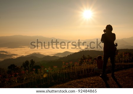 Photographer taking picture of landscape.