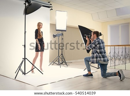 Photographer taking picture of  model in studio #540514039