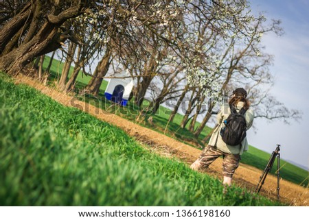 Photographer taking picture of Santa Barbara chapel in Moravian Tuscany, Czech Republic. Photography in nature. Springtime at rural scene