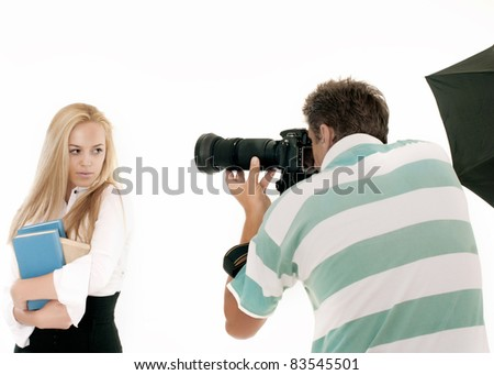 Photographer Taking Pictures of a Model in the Studio. It is not isolated