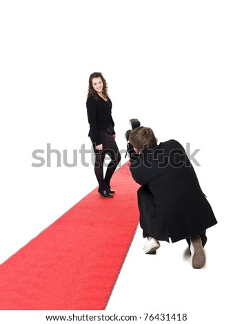 Photographer taking pictures on a woman posing on a red carpet
