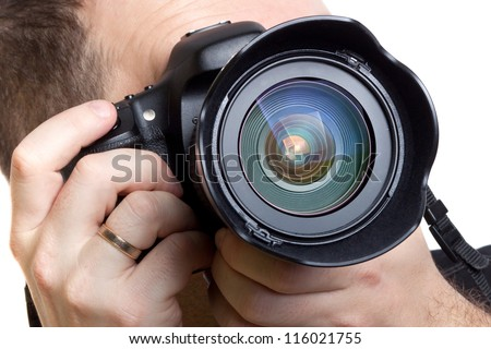 Photographer taking pictures with digital camera over white background