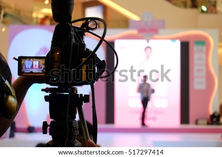 Photographer video recording activity within the event on Stage
