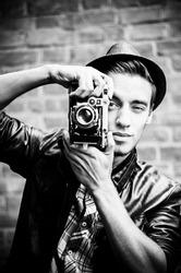 Photographer. Vintage stylized photo.