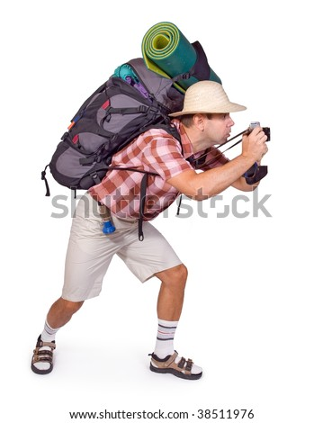 Photographer with a backpack on a trip. Curious hiker photographs. Tourist with a camera and a bag isolated on white background. Voyager photographs on a summer vacation. Traveler with camera and bag.