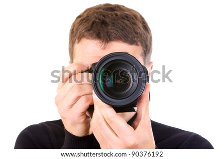 Photographer with a camera isolated on white. Focus is on the lens.