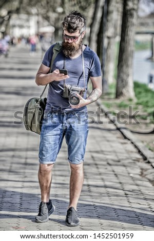Photographer with beard and mustache. Tourist shooting photos. Content creator. Man bearded hipster photographer. Old but still good. Photographer hold vintage camera. Modern blogger. Manual settings.