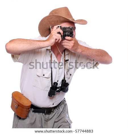 Photographer with camera dressed on safari suit. Studio shot isolated on white