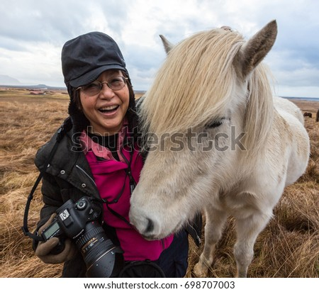 Photographer with Icelandic Horse that wanted to nuzzle on Nov 21, 2014