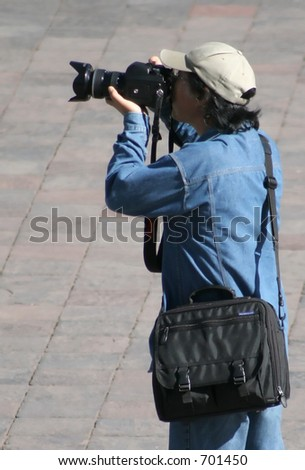 Photographer with large camera Cusco Peru