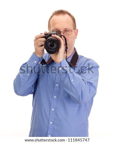 Photographer with reflex camera