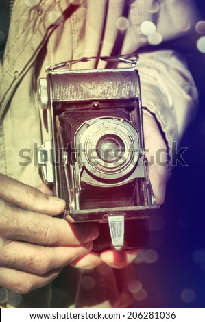 Photographer with vintage camera #206281036