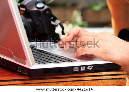 Photographer working on a laptop - stock photo