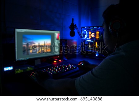 Photographers are editing computer images.