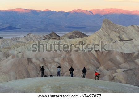 Photographers gather to shoot the sunrise from Zabriske Point in Death Valley National Park, California