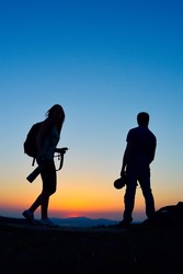 photographers outdoor at sunset