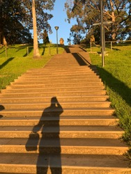 photographers shadow Not the sandstone Stair in Botanical Gardens located at Sydney NSW Australia on a nice sunset spring afternoon