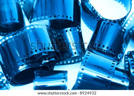 Photographic film pieces. Blue tint.