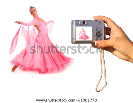 Photographing with point and shoot digital camera a beautiful young dancer