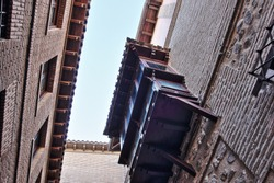Photographs in angle against chopped streets and facades of Toledo, Spain, narrow street, windows and balconies with wrought iron grills, art,