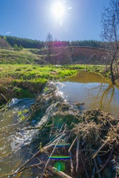 Photographs of a landscape, stream, Spring, Gully is a relief created by running water, rapidly collapsing into the soil, usually on a hillside. Gullies resemble large ditches or small valleys,