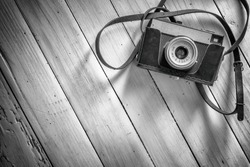 photography background with old camera and wooden table