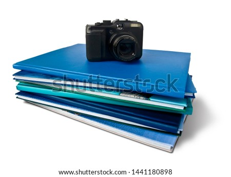 Photography books with a camera over them