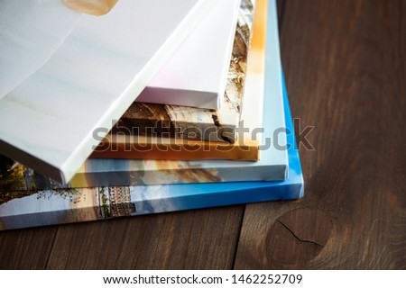 Photography canvas prints. Stacked colorful photos with gallery wrapping method of canvas stretching on stretcher bar, lateral side