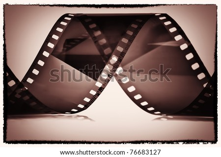 Photography film reel on a sepia vignetted background