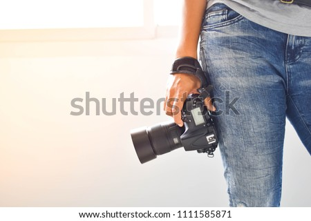 Photography is happiness, Photographers stand ready to work and  In the photographer's hand there is a camera.