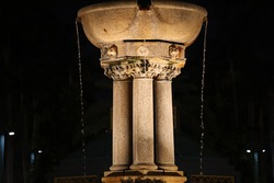Photography of a water fountain at night