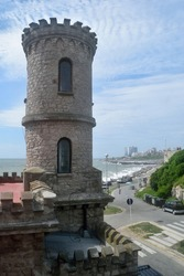 Photography of an old building known as Monk's Turret (Torreón del Monje) at Mar del Plata City whit the sea and the skyline on the background