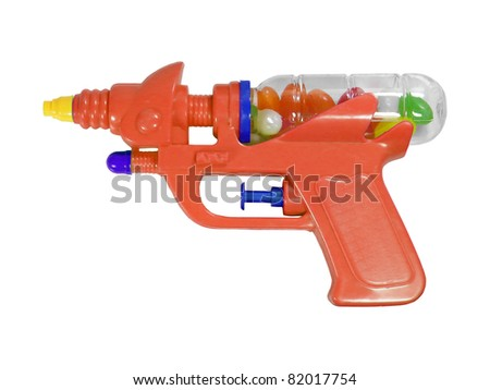 Photography of isolated plastic gun with candies