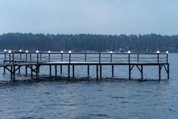 Photography of Istra water Reservoir landscape. Mysterious Russian winter. Wooden pier