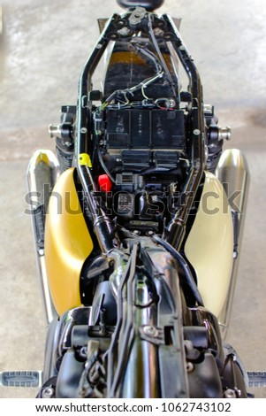 Photography of motorcycle part, fuse box ,fuel line,frame and wiring under the seat. #1062743102