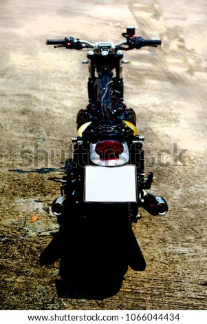 Photography of motorcycle part, fuse box ,fuel line,frame and wiring under the seat and fuel tank. #1066044434